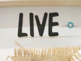 Primer plano de la palabra Live.