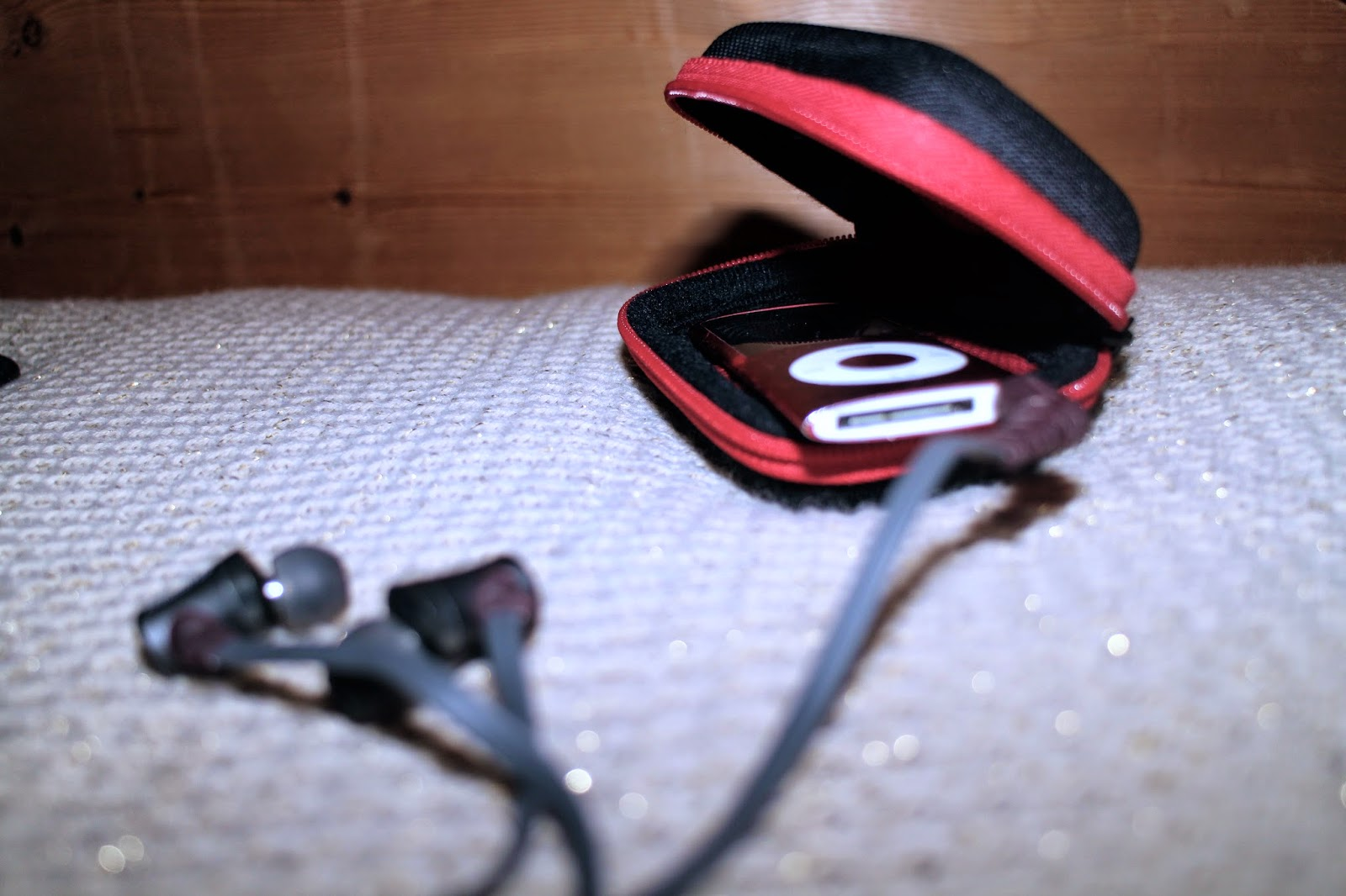 An iPod Nano and Brainwavs headphones
