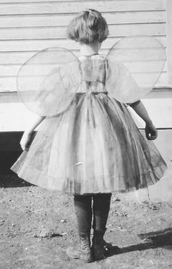 Vintage photo c. 1930s. Girl with short hair and handmade fairy wings. Children and Adults. marchmatron.com