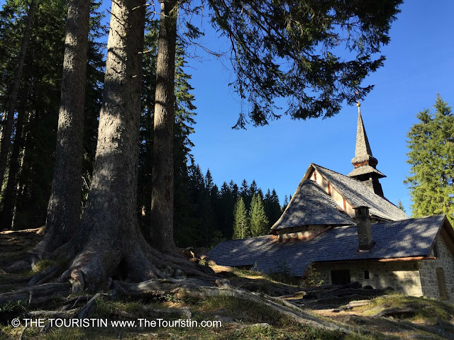 Travel Italy. Hiking at Lago di Braies in the UNESCO nature heritage listed Prags Dolomites Church