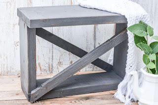 This small bench was constructed out of old boards and given lots of vintage charm with paint, wax, and a secret distressing technique.  See the full tutorial at www.andersonandgrant.com
