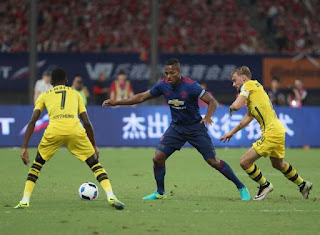 Ousmane Dembele scored the goal of the game as Thomas Tuchel outsmarted Mourinho to hand the Portuguese his first defeat since taking charge of United  Jose Mourinho's second game in charge of Manchester United brought his first defeat as his team lost 4-1 to lively Dortmund side in Shanghai.