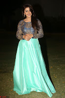 Nikki Galrani in Green Skirt  Top at Marakathamani music launch ~  Exclusive (148).JPG