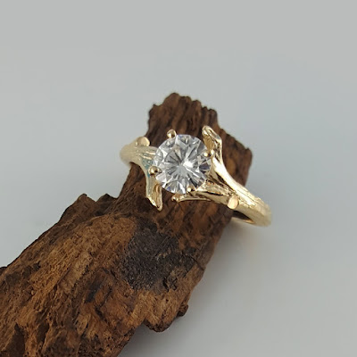 This is my original bud branch design with a 6.5 mm moissanite stone from the forever brilliant collection from Charles & Colvard. This listing is for two rings, an engagement ring and coordinating band. These rings are solid 14k or 18k gold. The rings also come with a certificate for the moissanite stone from Charles & Colvard.