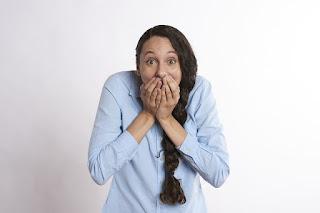 woman-hiding-mouth.jpeg