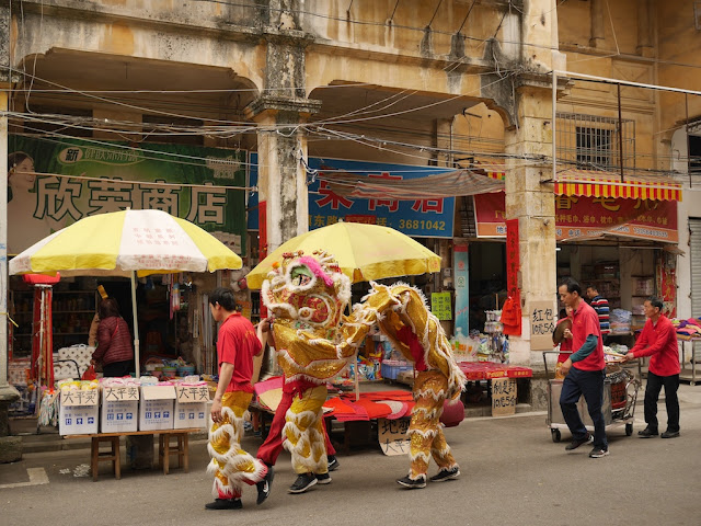 Lion dance troupe on a street in Jiangmen