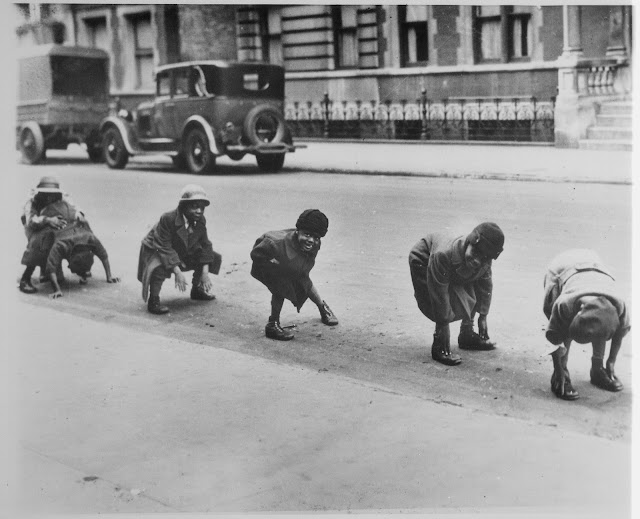 Vintage photo Little boys play leapfrog in the street.  Little Scraps of Wisdom. marchmatron.com