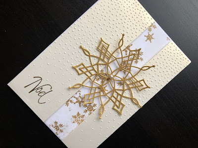 Hand made Christmas card with a dry embossed background and a large, gold die cut snowflake