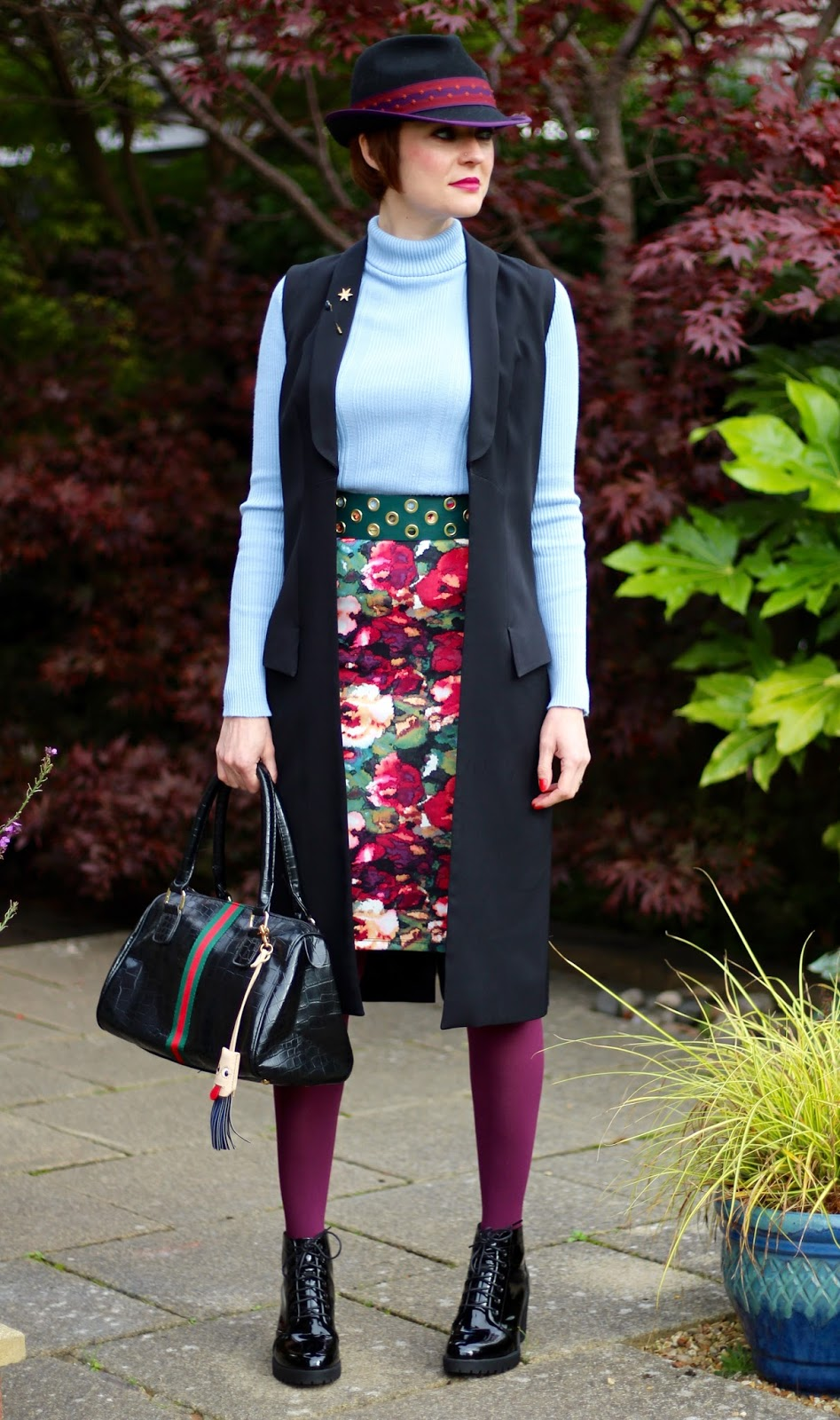 Black sleeveless Waistcoat | Grounding a colourful outfit