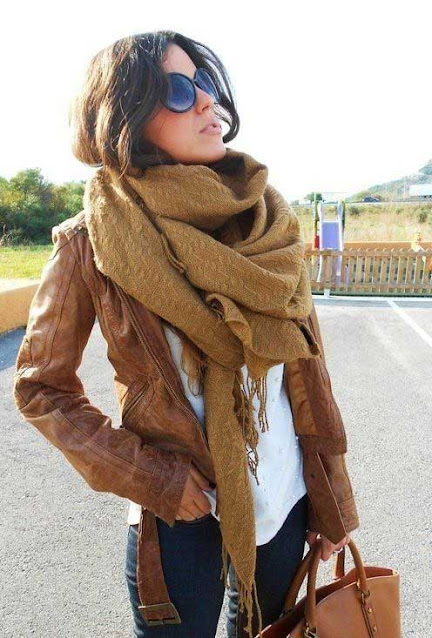 Vintage Look: Faded brown leather jacket paired with a white tee