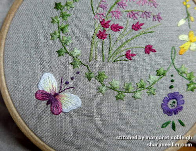 Butterfly embroidered with variegated threads on Herbier surface embroidery project