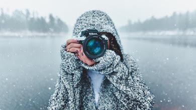 Photographer with Nikon Camera