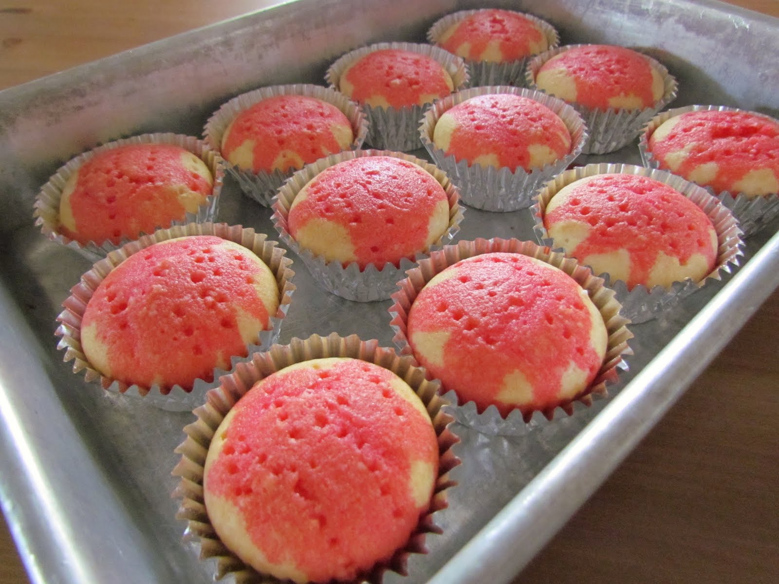 Strawberry Jell-O Poke Cupcakes