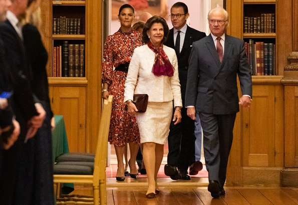 Crown Princess Victoria wore Dagmar Dora dress, and Cravingfor Jewellery baroque pearl earrings. Queen Silvia wore a lace skirt