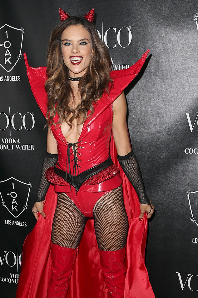 Alessandra Ambrosio flashes in a racy red devil costume at her Halloween party