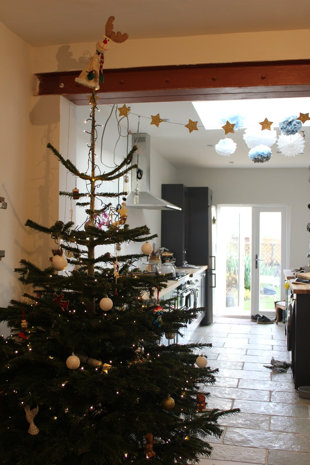 classic christmas tree in kitchen