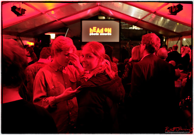 HeadOn Photo Festival launch in Paddington Sydney - Portrait in deep red lighting reminiscent of being in a black and white print processing darkroom. Photo by Kent Johnson for Street Fashion Sydney.