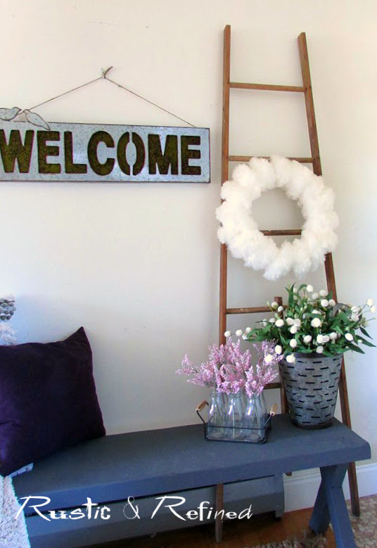 Decorating a small entryway with muted colors and farmhouse decor.