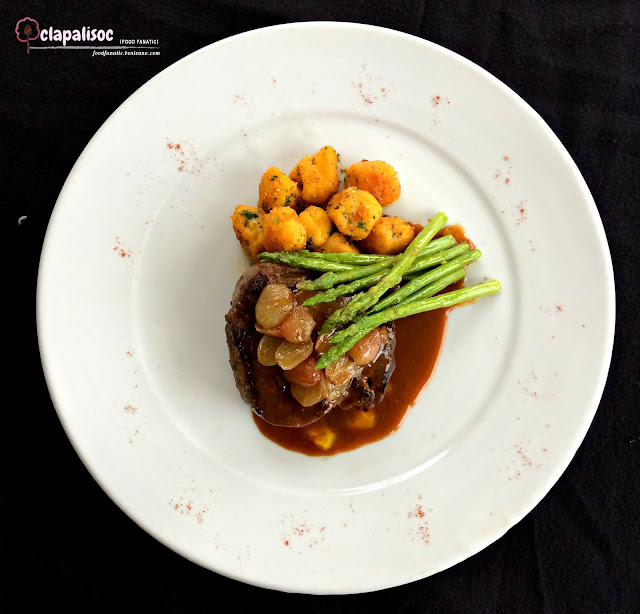 Grilled Beef Tenderloin in Orange Grape Brown Sauce served with Pumpkin Gnocci