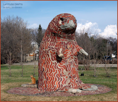 mosaic statue of giant beaver, with orange kitten, Regina, SK
