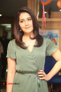 Actress Raashi Khanna Stills in Green Short Dress at Mirchi 95 Suno Aur Mercedes Jeeto Contest  0016.JPG