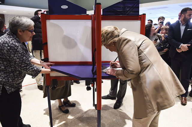 image of Hillary Clinton voting for herself