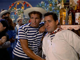Giuliano Gemma with fellow Italian actor Alberto Sordi pictured in a scene from the film Venezia, la luna e tu