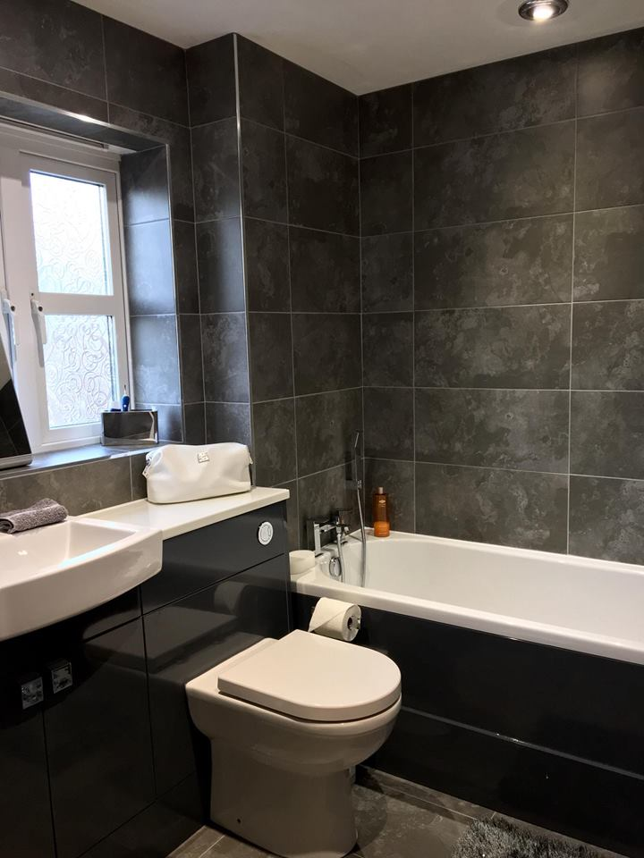 Dark Grey Tiles and Glossy White Bathroom