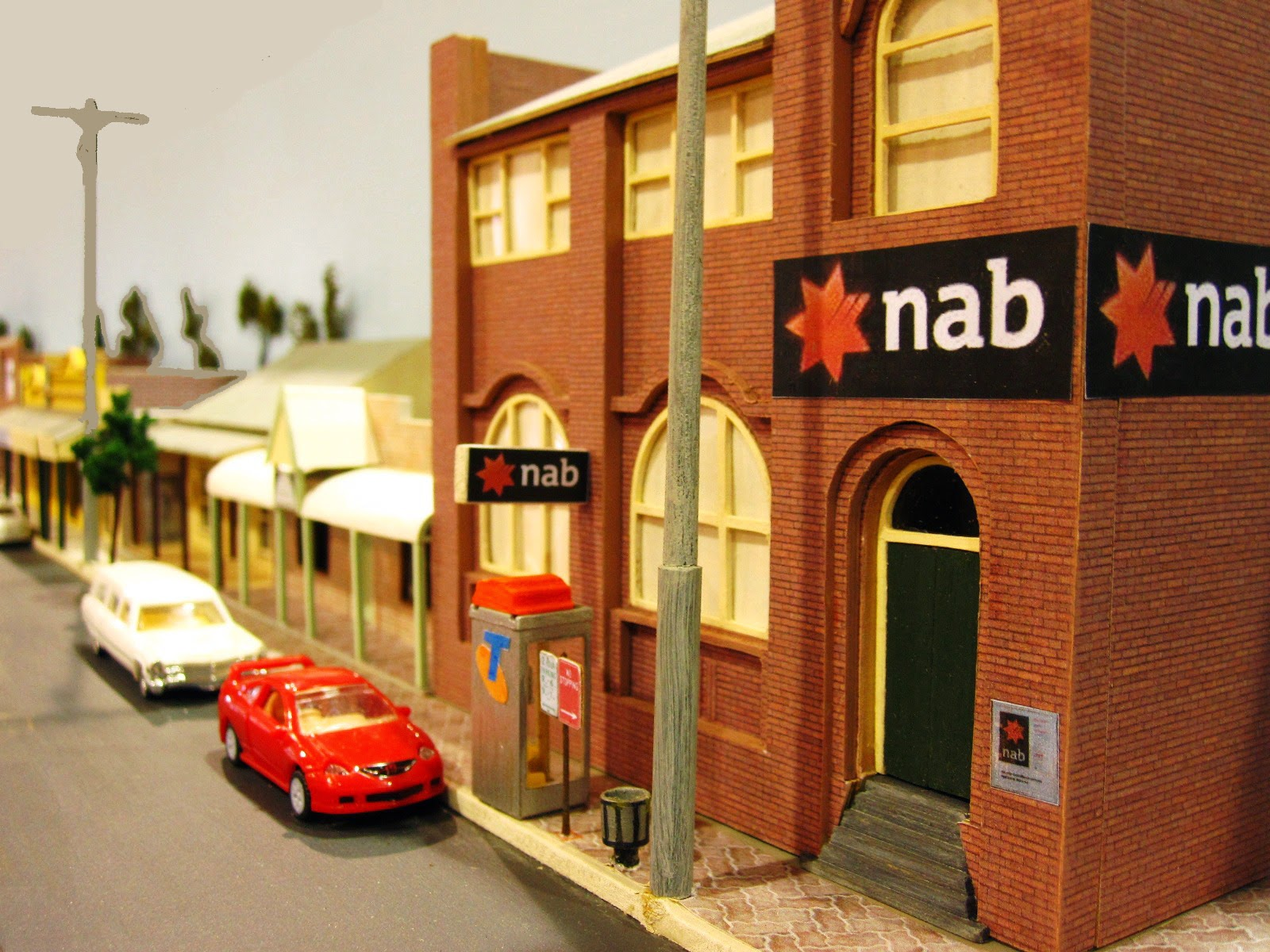 Quarter inch scale modern Australian town street scene with National Australia Bank building on the corner.
