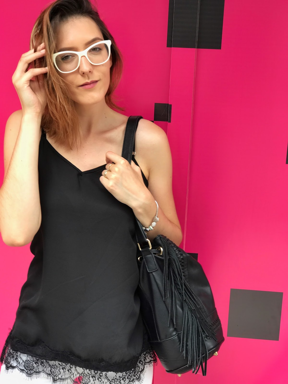 Black and white outfit pink wall