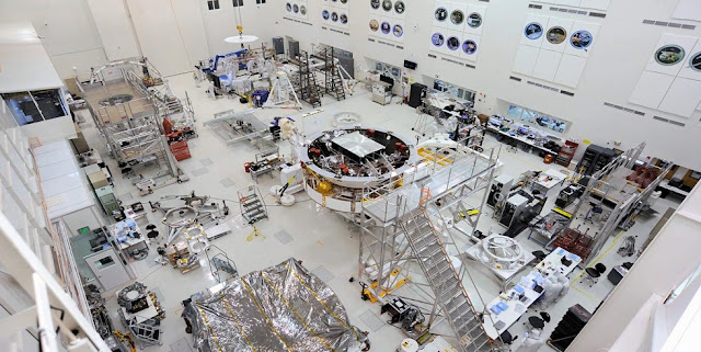 This image shows major components of NASA's Mars 2020 mission in the High Bay 1 clean room in JPL's Spacecraft Assembly Facility.  In the center of Figure 1 is the Mars 2020 spacecraft stack attached to the Spacecraft Assembly Rotation Fixture (SCARF).  JPL will build and manage operations of the Mars 2020 rover for the NASA Science Mission Directorate at the agency's headquarters in Washington. Credit: NASA/JPL-Caltech