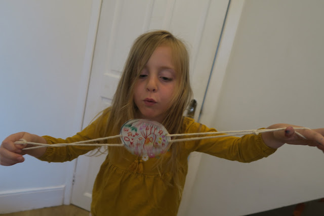 Lily blowing the spinner