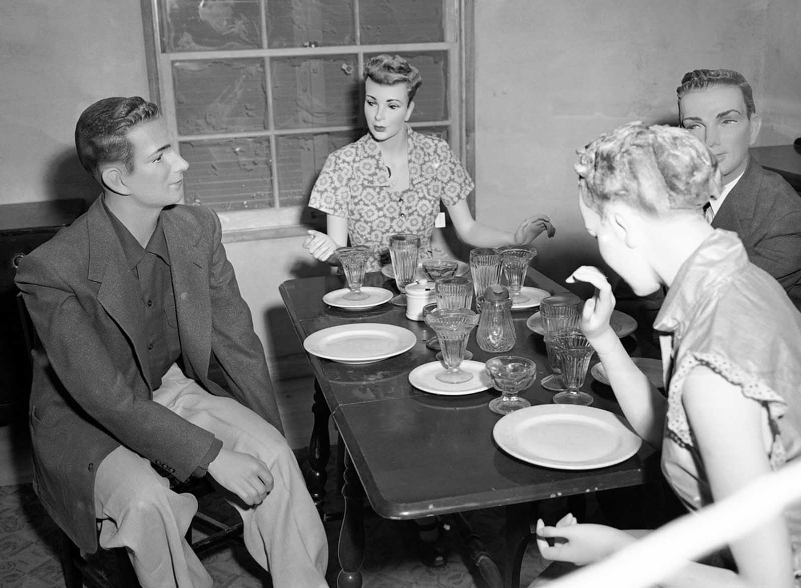 "In Operation Doorstep, conducted during the larger Operation Upshot-Knothole nuclear bomb test, mannequins are seated at a table in the dining room of House No. 2, attending a ""dinner party"" thrown by Civil Defense officials who are testing the effects of an atomic explosion on houses and occupants on March 15, 1953."