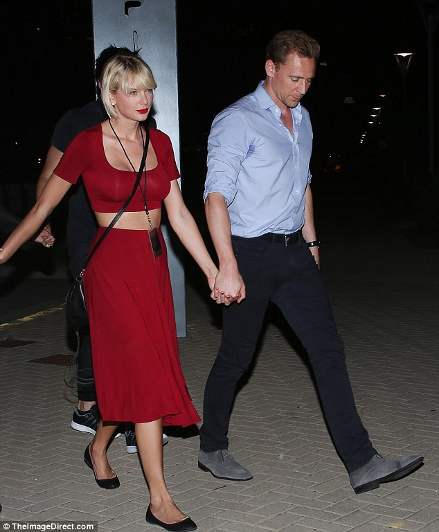 Taylor Swift holds hands with Tom Hiddleston after Selena Gomez concert