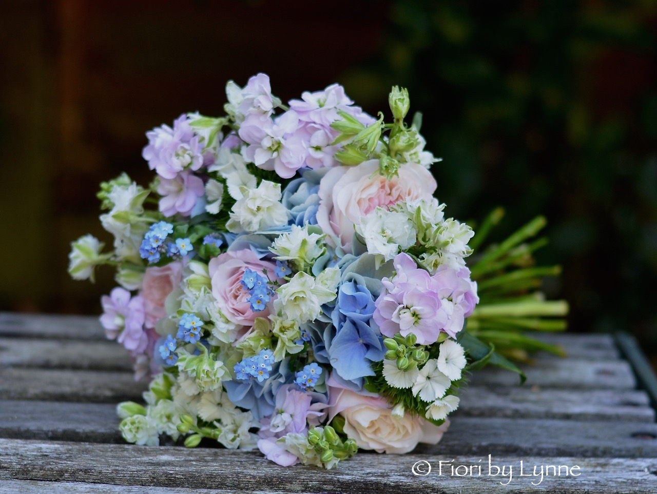 Wedding flowers blog claires english summer garden style flowers bridesmaids posy of english summer garden style flowers in soft pinks and blues using garden roses hydrangeas stocks larkspur forget me not and sweet izmirmasajfo