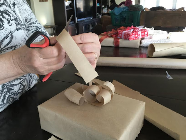 Making bows from brown craft paper