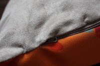 Close up of cushion front, back and zip