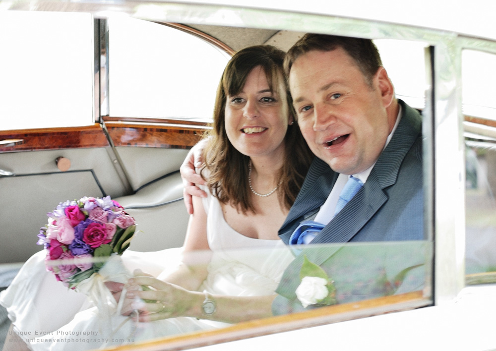 Bride and groom in the vintage Rolls Royce, Wedding Photographer Sydney; Unique Event Photography.