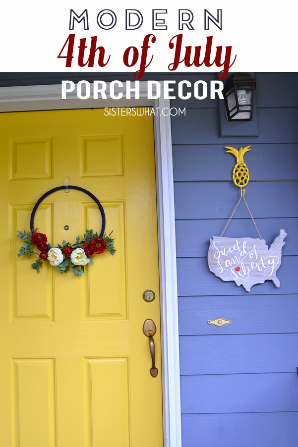 Modern 4th of July porch decor using simple flower wreath and hand lettered usa wood sign