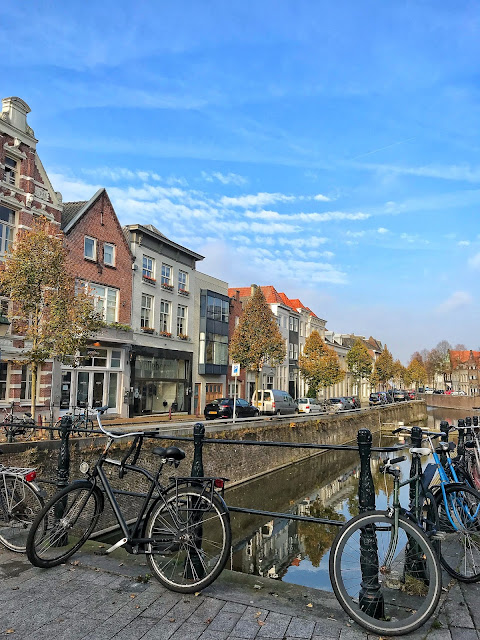 Canal reflections and the bikes of Den Bosch The Netherlands