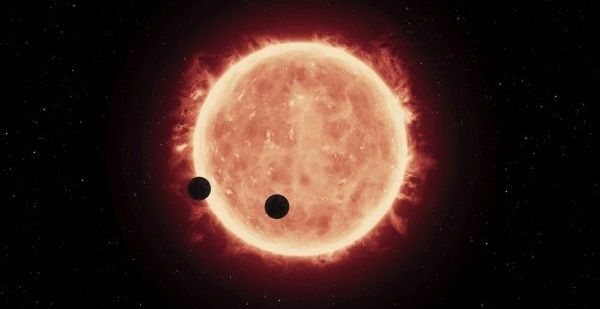 Artist's impression of Earth-sized planets orbiting a red dwarf star. (Image: NASA, ESA, and G.Bacon (STScI))
