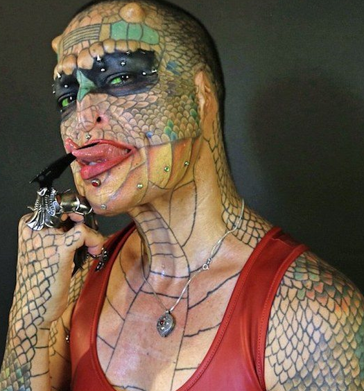 Transgender woman spends thousands of Dollars to look like a dragon