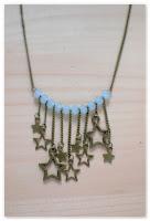 sautoir bronze et bleu clair étoiles filantes