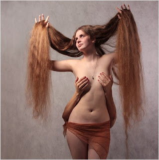http://girls-very-long-hair.blogspot.com/2010/07/long-hair-photos-elizaveta-orlova.html