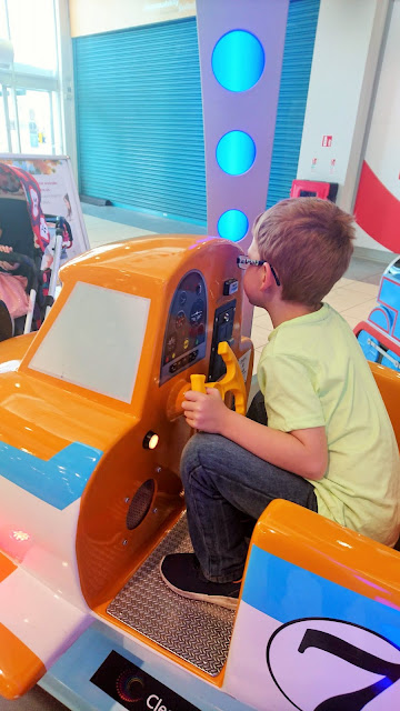 Dylan Playing inside an orange airplane ride.  Project 365 Day 198 on the 17th July 2018 from Us Two Plus You