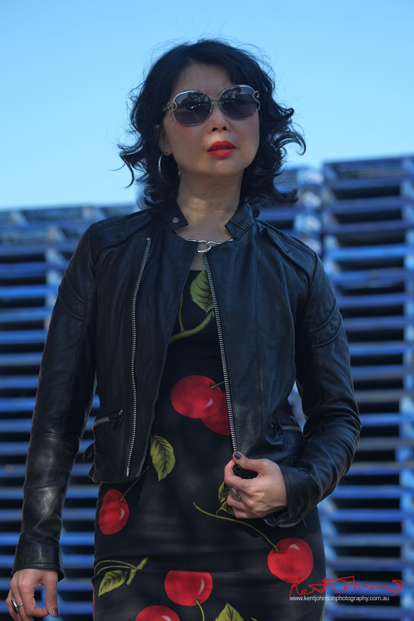 Industrial zone photoshoot with an empahasis on blue red and black. Marrickville Sydney, Cherry Dress, Leather Jacket, Sunglasses, with Fashion Blogger vivalaViv. Photographed by Kent Johnson.
