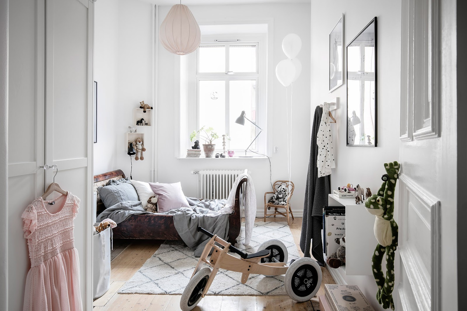 stylish kids nursery room inside of a small scandinavian apartment