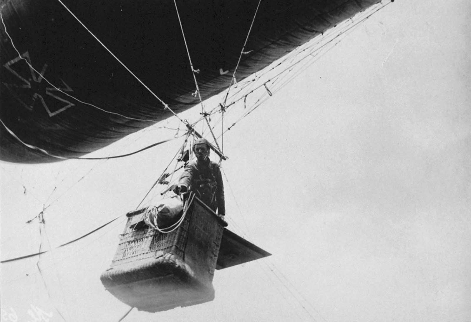 Observer in a German balloon gondola shoots off light signals with a pistol.