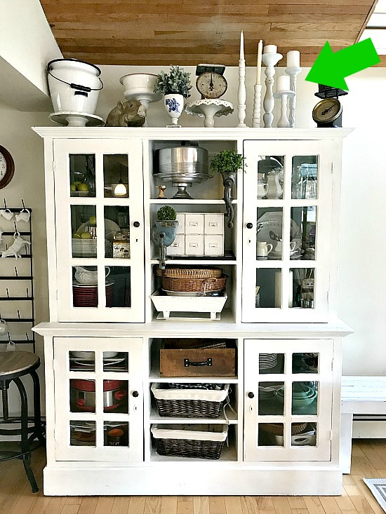 Farmhouse hutch with white candlestick collectionl