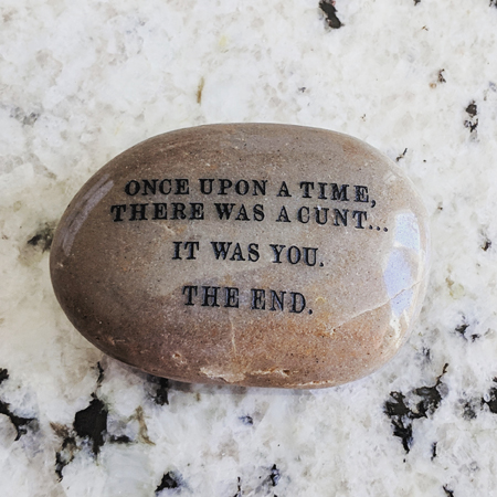 image of en engraved stone sitting on my kitchen counter, reading: 'Once upon a time,there was a cunt... It was you. The end.'
